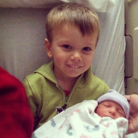 Meeting his baby brother
