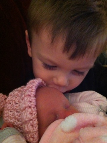 Kissing his little sister