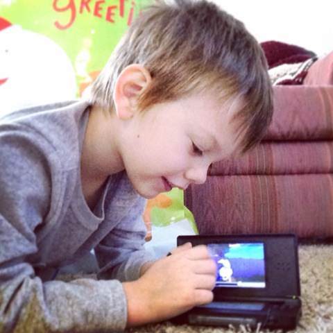 Playing his DS